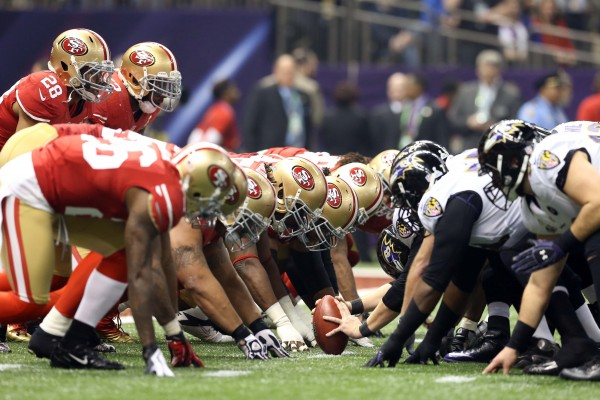 Members of the San Francisco 49ers and Baltimore Ravens line up across the line of scrimmage in the third quarter in Super Bowl XLVII at the Mercedes-Benz Superdome.