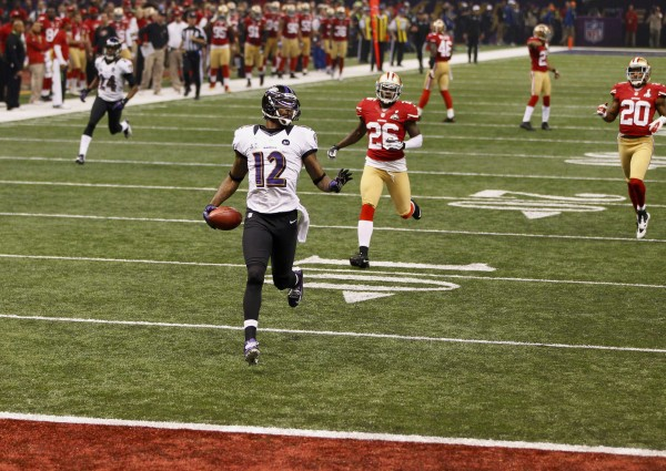 Baltimore Ravens wide receiver Jacoby Jones (12) runs back the opening kick-off of the second half for a 109 yard touchdown against the San Francisco 49ers in the NFL Super Bowl XLVII football game.