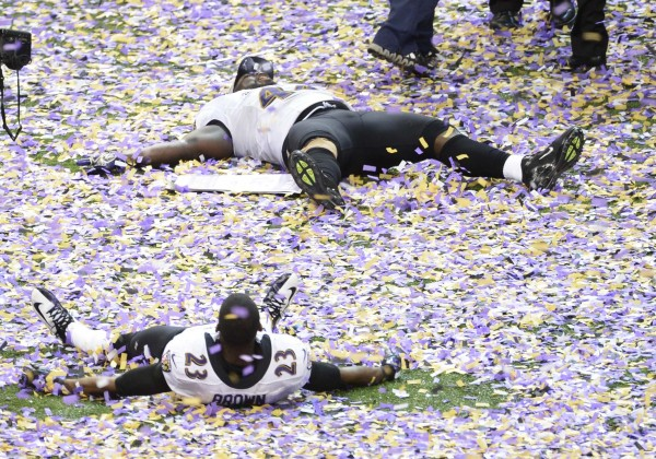 Baltimore Ravens fullback Vonta Leach (top) and defensive back Chykie Brown (23) celebrate after defeating the San Francisco 49ers 34-31 in Super Bowl XLVII at the Mercedes-Benz Superdome.