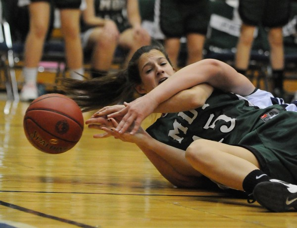 Mount Desert Island's Bailey Burr gets wrapped up by Presque Isle's Meredith Stewart while chasing a loose ball during second half action on Wednesday, Feb. 20, at the Bangor Auditorium during Class B tourney action. PI won 62-48.