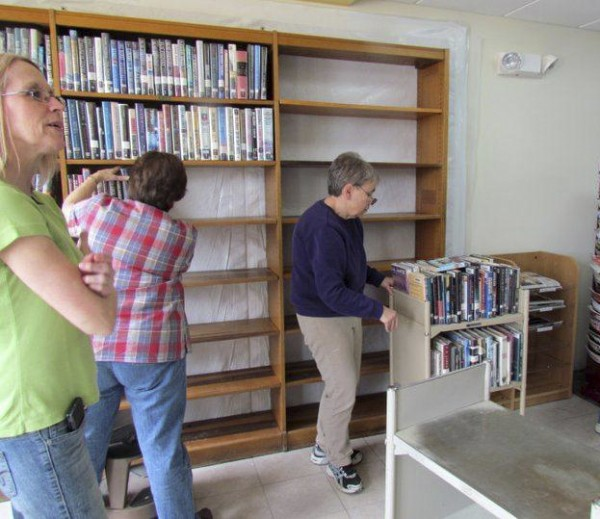 Staff and volunteers help move items and stack books on the shelves at the Mark and Emily Turner Memorial Library in Presque Isle on May 20, 2011. The library underwent the first phase of renovations in 2011 and will enter the second phase in the spring of 2013.