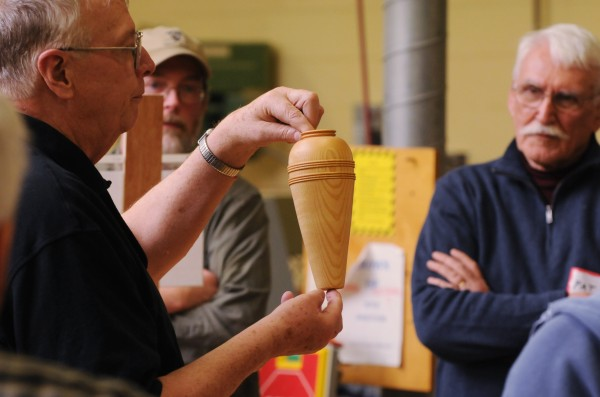 Buzz Small shows off a wood turning he crafterd during the show-and-tell portion of the monthly meeting of Eastern Maine Woodturners at Eastern Maine Community College on Thursday, Jan. 31, 2013.