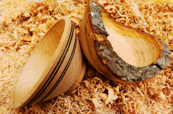 A pair of cherry wood bowls sit on the shavings under a wood lathe used to create them during a wood turning demonstration by Carl Winter at the monthly meeting of the Eastern Maine Woodturners at the Eastern Maine Community College in Bangor on Thursday, Jan. 31, 2013.