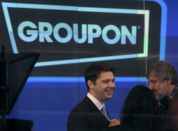 Groupon CEO Andrew Mason (left) prepares for the opening bell ceremony celebrating his company's IPO at the Nasdaq Market in New York in this Nov. 4, 2011, file photo. Groupon Inc. replaced Mason on Feb. 28, 2013, a day after posting a dismal set of quarterly results, and appointed co-founder Eric Lefkofsky and board member Ted Leonsis as interim chief executives.