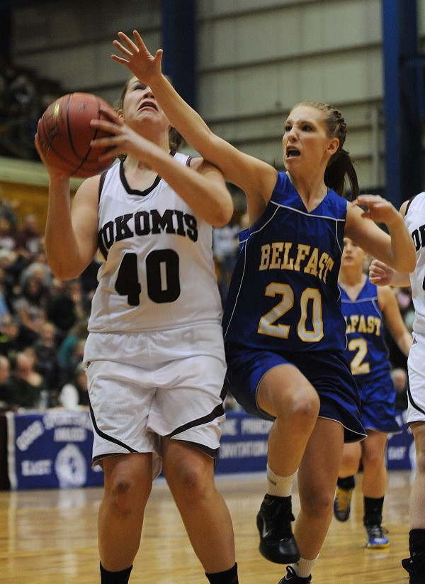 Nokomis's Anna Mackenzie gets her shot blocked by Belfast guard Madison Cummings during first half action at the Bangor Auditorium on Friday, Feb. 15, 2013.
