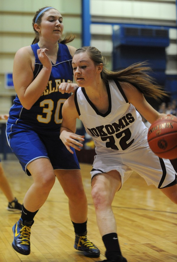 Nokomis's Taylor Shaw drives to the hoop against Belfast's Mckenzie Thibodeau at the Bangor Auditorium on Friday, Feb. 15, 2013.