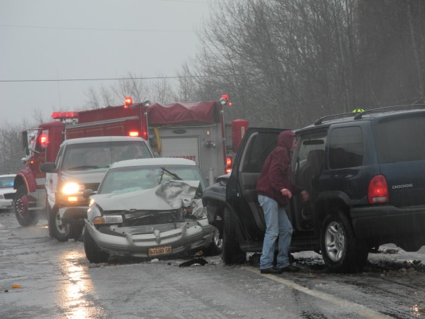 Rescue crews work Monday afternoon at the scene of a multiple vehicle crash on U.S. Route 1 in Northport where three people were injured.