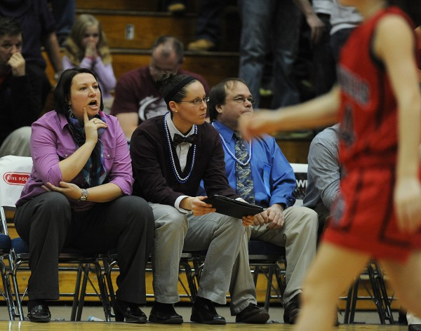 Nokomis High School assistant coaches Kelly Flagg (left) and Tanna Ross look on from the bench during Wednesday's Eastern Maine Class B girls' basketball semifinal at the Bangor Auditorium. Both are former University of Maine players.