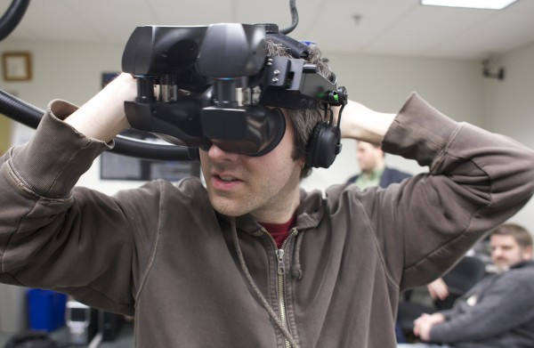 Senior mechanical engineering student, Tim McGrath puts on a virtual reality headset in the Virtual Environment and Multimodal Interaction Laboratory at the University of Maine on Friday, Feb. 8, 2013.