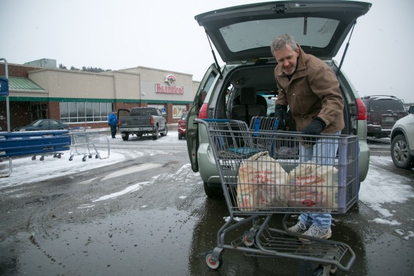 Jason Carlisle unloads groceries at the Hannaford grocery store on Broadway in Bangor on Feb. 8, 2013. Carlisle said he wasn't stocking up for the storm but thought it was good idea to get some shopping out of the way before it hit.