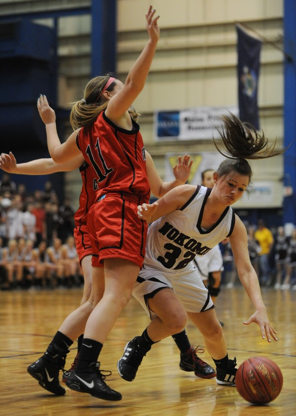 Nokomis' Kelsie Richards works her way past Camden Hill's Kristina Keiran during first-half action on Wednesday, Feb. 20, 2013, at the Bangor Auditorium during class B tourney action.