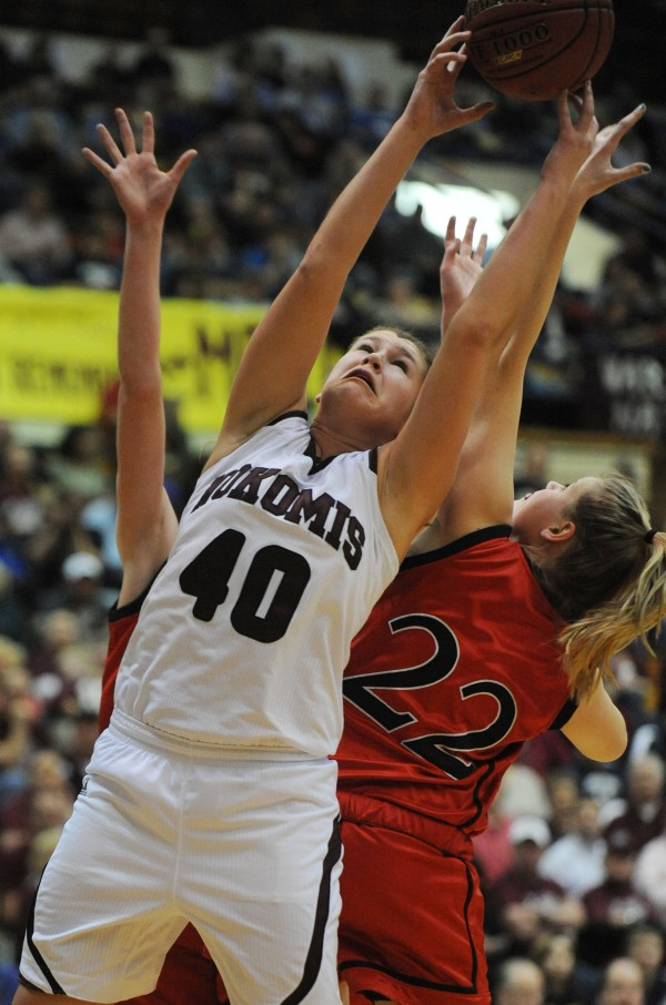 Nokomis' Anna Mackenzie vies for a rebound against Camden Hill's Bekah Hilt during first-half action on Wednesday, Feb. 20, 2013, at the Bangor Auditorium during Class B tourney.