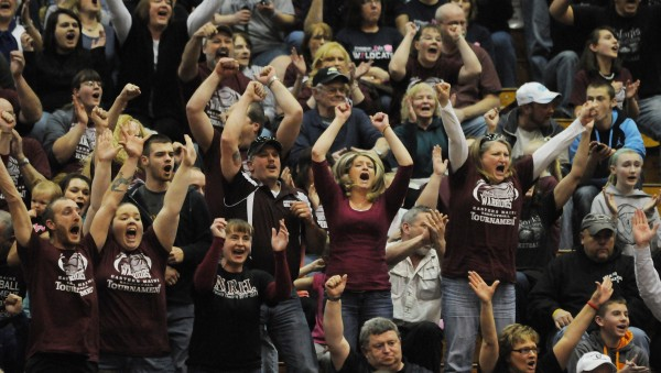 Nokomis fan cheer as the final seconds tick off the clock. The Nokomis girls team beats Camden Hill's 45-40 on Wednesday, Feb. 20, 2013, at the Bangor Auditorium during Class B tourney action.
