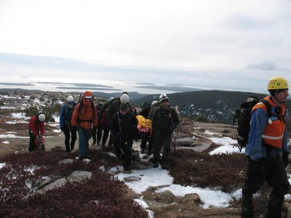 Acadia National Park rangers and members of Mount Desert Island Search and Rescue carry out a man who fell on the South Trail on Cadillac Mountain and possibly broke his hip on Wednesday, Feb. 27, 2013. The man, whose name is not being released, was hiking alone and had to wait for five hours before another hiker came along and called for help.