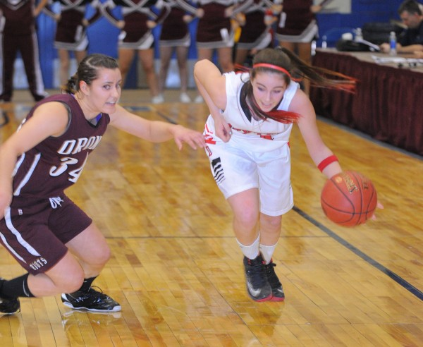 Dexter's Michaela White (right) drives past Orono's Elea Kassby during the first half of the game Friday afternoon.