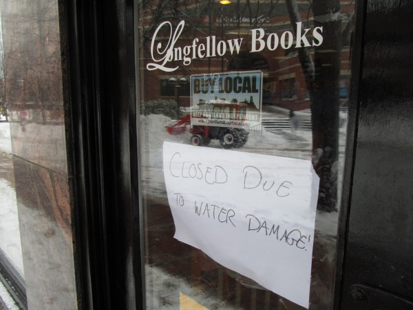 A sign on the door of Longfellow Books in Portland on Monday, Feb. 11, 2013, tells customers the store has been closed due to damage incurred in the weekend's storm.