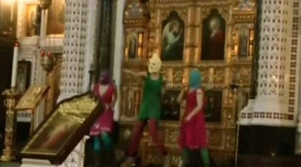 Members of the female punk band Pussy Riot stage a protest inside Christ The Saviour Cathedral in Moscow on Feb. 21, 2012, in this still image taken from video.