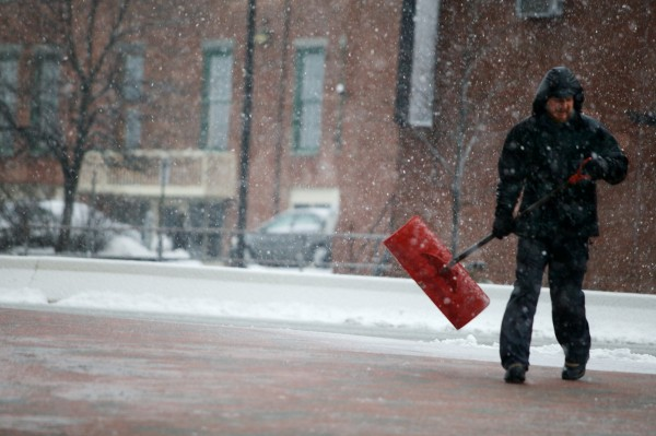 Zeb Raszmann shovels a sidewalk on the the corner of Temple and Spring streets in Portland on Wednesday, Feb. 27, 2013, as the latest winter storm pelts the city with rain, snow and wind.