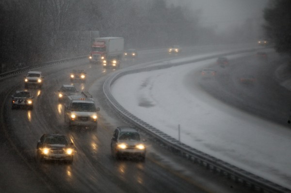 Motorists makes their way north on Interstate 295 through Portland on Wednesday, Feb. 27, 2013, as a winter storm pelts the city with wind, snow and rain.