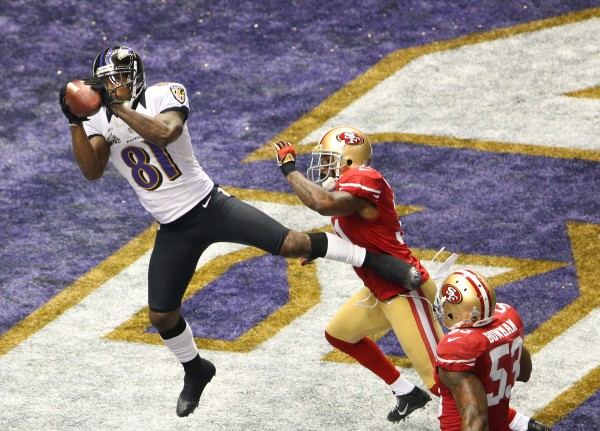 Baltimore Ravens wide receiver Anquan Boldin (81) makes a catch for a touchdown against San Francisco 49ers strong safety Donte Whitner (31) during the first quarter in Super Bowl XLVII at the Mercedes-Benz Superdome.