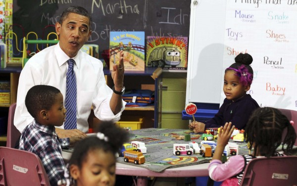 President Barack Obama sits in a classroom at the Yeadon Regional Head Start Center in Yeadon, Pa., in this November 8, 2011 file photo. Child care programs such as Head Start could be on the list of cutbacks as the White House warns of possible damage to public services, from less child care to air travel chaos, from the $85 billion across the board budget cuts that are due to begin March 1.