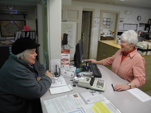 Denise Goodman (left), a U.S. Census Bureau employee, confers Friday afternoon, Feb. 1, 2013, with Doris Weed at the Lincolnville town office. Weed is retiring from her post after 27 years of employment.