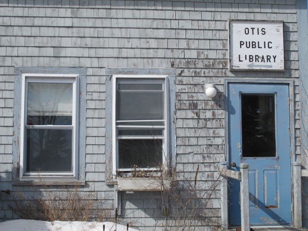 Otis residents will decide at a special town meeting on March 25 whether to spend up to $600,000 replacing the worn-down building that houses the library and town office.