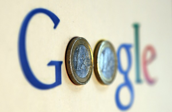 An illustration picture shows a Google logo with two one Euro coins, taken in Munich in this January 15, 2013 file photograph