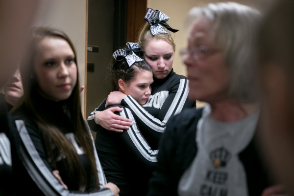The Houlton cheerleading team receives a final pep talk from their coach before performing at the Maine state cheerleading championships.