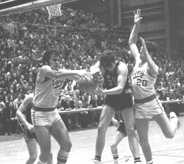 Cony's Dave Rollins (left) fights for control of a rebound with Mount Desert Island's Russ Gray during their Eastern Maine Class A final on March 10, 1973 at the Bangor Auditorium. Also in on the action is Cony's Neal Glazier. Cony won the EM title and went on to beat Rumford in the state final.