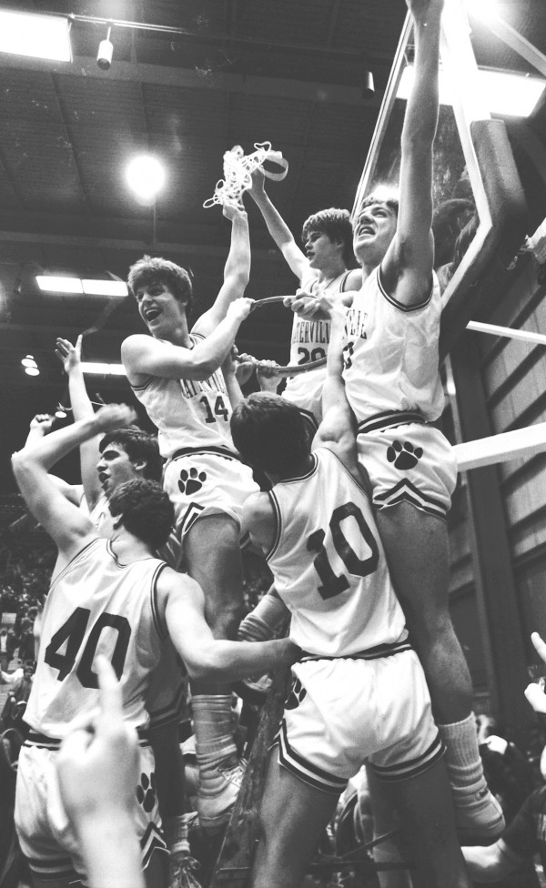 The Waterville Panthers take down the state championship nets for the first time since 1949 after defeating South Portland 60-35 for the Class A state title on March 16, 1985 at the Bangor Auditorium. Clockwise from bottom are Kevin Whitmore (40), Joe Jabar, Dick Whitmore, Todd Hanson, Chris Hill and David Mizner.