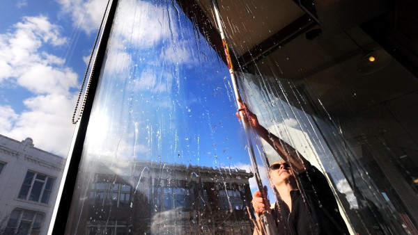 Sonya Eldridge, owner of Bagel Central in Bangor, washes the windows of her business Tuesday afternoon. &quotI have not had a chance to do this since October. It is such a nice day to do it,&quot Eldridge said while working in what felt like T-shirt weather. According to the National Weather Service, the weather is expected to change and a significant winter storm is going to hit the state by Wednesday evening.