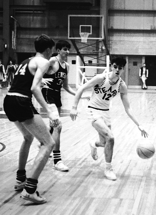 Stearns standout Jon MacDonald (12) starts a drive to the basket while Lewiston defenders Mike Wolford (14) and Dick Giroux move in to cover him during the Class LL state final at the Bangor Auditorium on March 22, 1965.