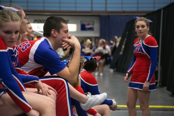 The Mt. Ararat High School cheerleading squad awaits their score following their performance at the Kennebec Valley Athletic Conference cheerleading competition.