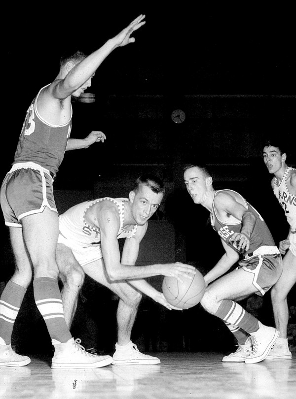 Stearns' John Madore finds himself well-guarded by Morse's Joe Harrington (left) and Fred Woods during the Class LL state final on March 9, 1963 at the Bangor  Auditorium. Morse beat Stearns 61-60 in double overtime.