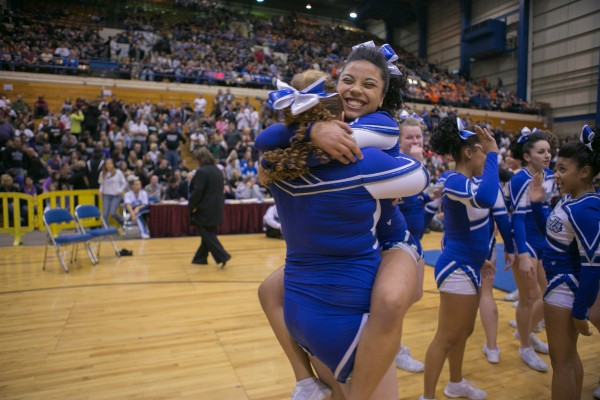 The Lewiston High School cheerleading team celebrates after performing at the Maine state championships.