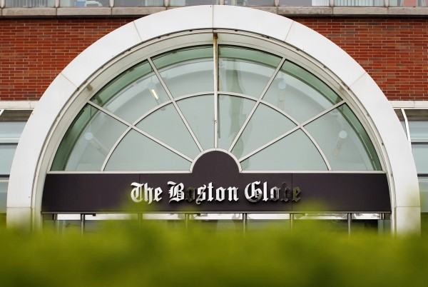 The Boston Globe's logo is seen at the entrance of the newspaper's building in Boston, Mass., in this June 15, 2009, file photo. The New York Times Co. will try to sell The Boston Globe for a second time as it attempts to shed one of its last properties, according to a company statement, Feb. 20, 2013.