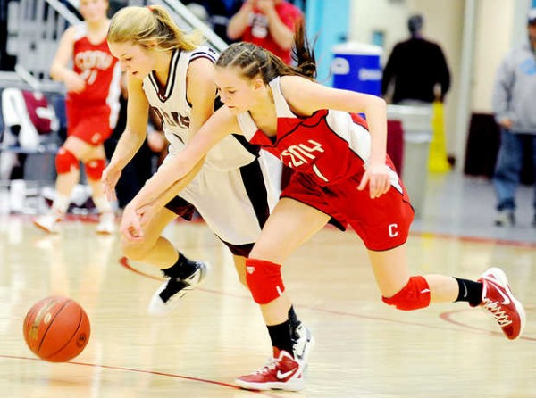Ashlee Arnold (left) of Edward Little High School and Emily Quirion of Cony High School chase down a loose ball during the second period in Augusta on Friday.