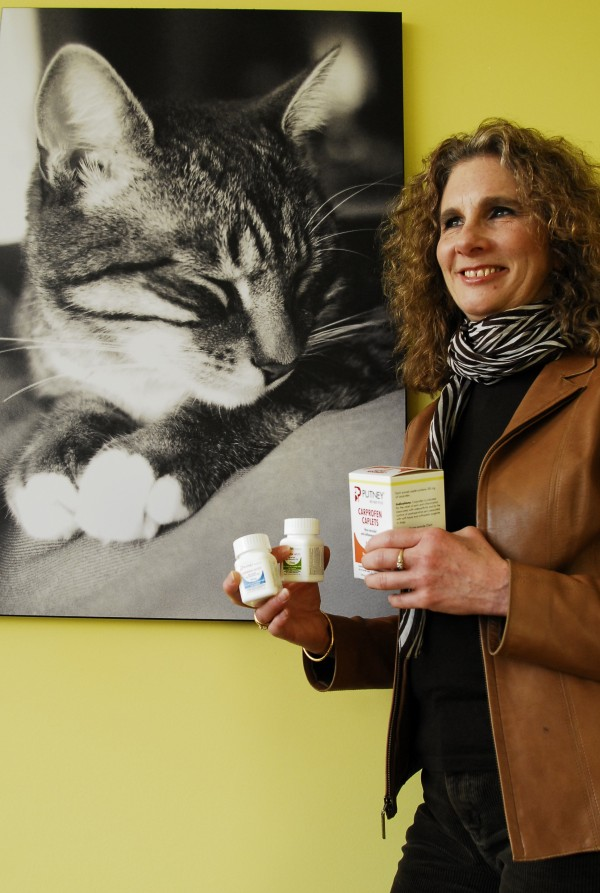 Jeanne Hoffman, chairman, president and CEO of Putney Inc., holds samples of some of the generic medication the company offers to veterinarian practices in February 2012.