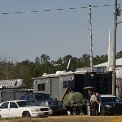 Alabama school bus shooting suspect holing up in bunker, police say