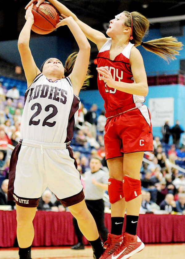Josie Lee of Cony blocks a shot by Kory Norcross of Edward Little during the fourth quarter in Augusta on Friday.