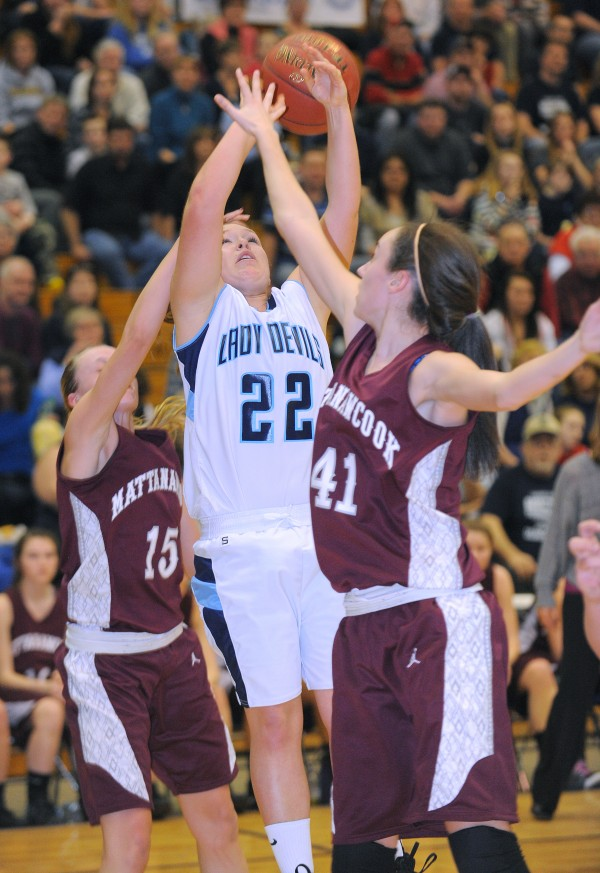 Mattanawcook's Mikaila Bisson (left) and Taylor Blood (right) block a shot by Calais' Olivia Smith during the first half of the game in Bangor on Friday afternoon, Feb. 22, 2013.