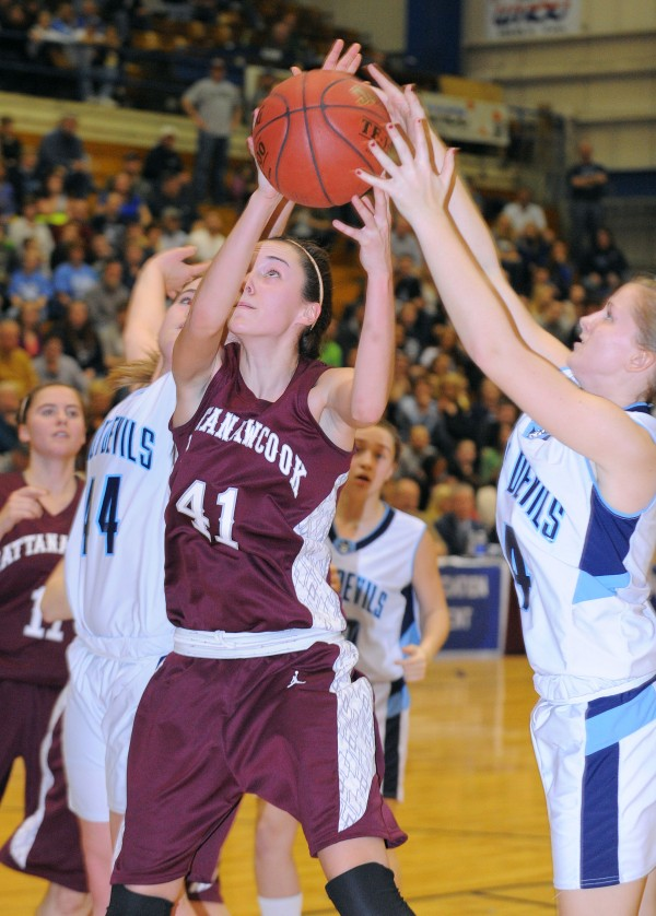Mattanawcook's Taylor Blood (center) scrambles for the rebound with Calais' Paige Gillespie (left) and Mallory Black during the second half of the game in Bangor on Friday afternoon, Feb. 22, 2013.