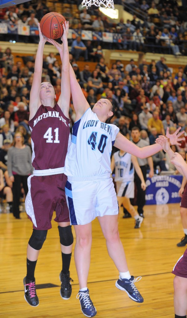 Mattanawcook's Taylor Blood (left) and Calais' Sierra Young go up for a rebound during the first half of the game in Bangor on Friday afternoon, Feb. 22, 2013.