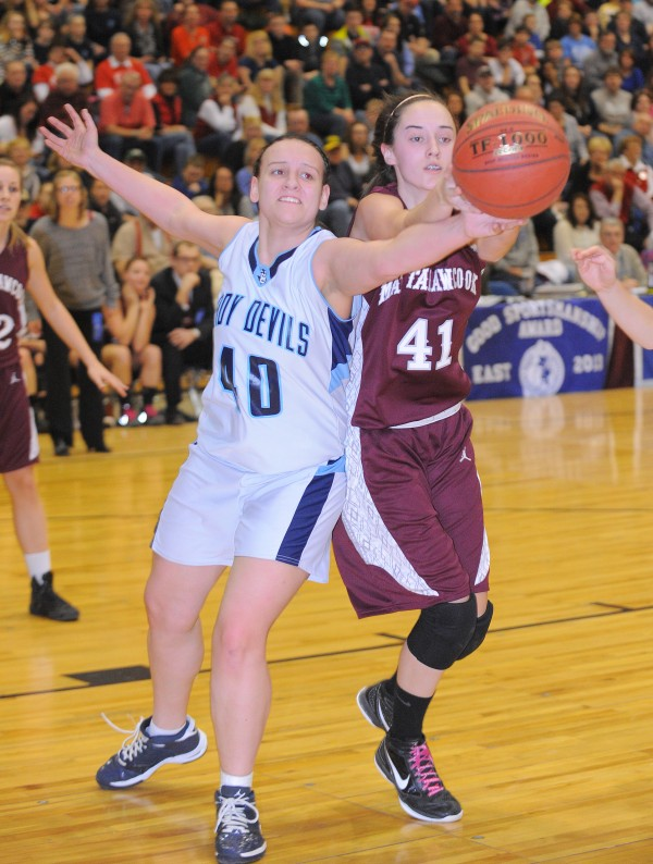Calais' Sierra Young (left) and Mattanawcook's Taylor Blood scramble for the ball during the first half of the game in Bangor on Friday afternoon, Feb. 22, 2013.