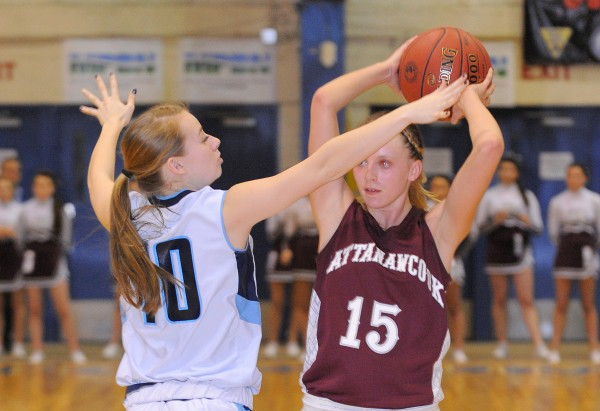 Mattanawcook's Mikaila Bisson (right) is pressured by Calais' Meaghan Cavanaugh during the second half of the game in Bangor on Friday afternoon, Feb. 22, 2013.
