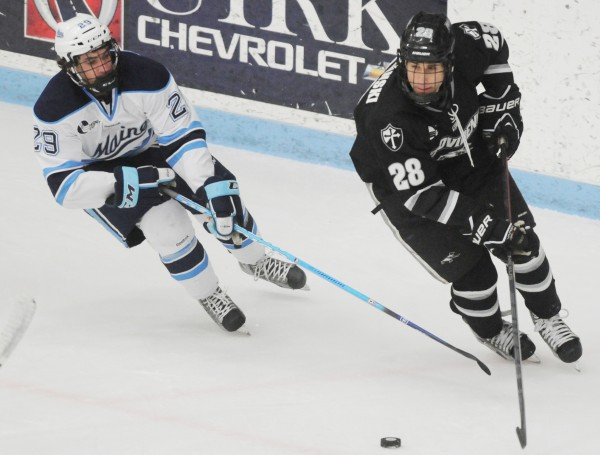 UMaine's Conor Leen moves in on Providence's Steven Shamanski during first-period action at Orono on Friday, Feb. 1, 2013.