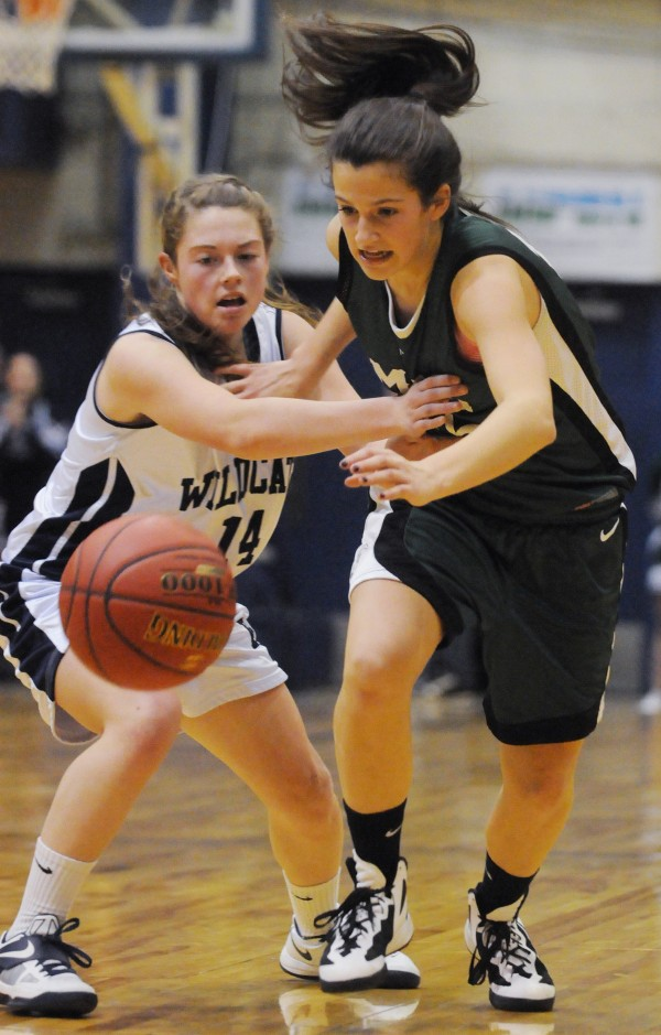 Mount Desert Island's Bailey Burr and  Presque Isle's Chandler Guerrette chase down a bad pass during second half action on Wednesday at the Bangor Auditorium during Class B tourney action.