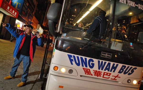 Frank Torres, resident of Brooklyn and employee of Fung Wah bus company enthusiastically rangles the last few passengers on the 5:00pm bus to Boston out of Canal Street, Chinatown, in New York. At $15 per ticket they need full buses.