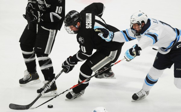 UMaine's Steven Swavely battles for control of the puck with Providence's Tim Schaller during first-period action at Orono on Friday, Feb. 1, 2013.